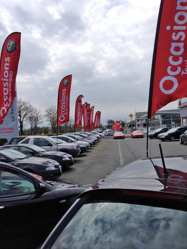 Voiles publicitaires spéciales garage automobile